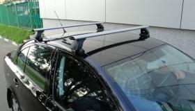 Водителей в России начали штрафовать за багажник на крыше авто – это законно?